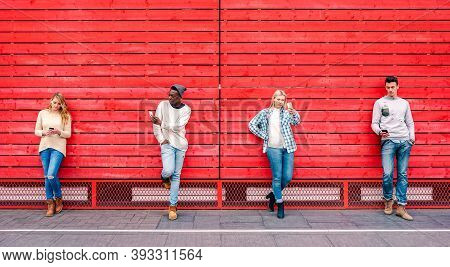 Multicultural Friends Group Using Smartphone By Red Wooden Background - Technology And Urban Lifesty