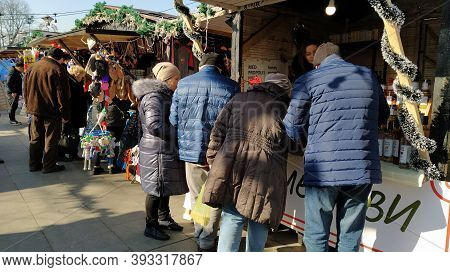 Belgrade, Serbia - January 24, 2020 People In Warm Jackets Are Looking At Goods In A Street Shop. Th