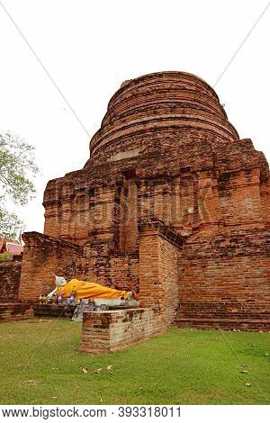 The Historic Stupa (chedi) Ruins With A Reclining Buddha Image In Wat Yai Chai Mongkhon Temple, Ayut