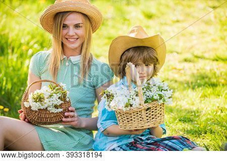 Motherhood Happiness. Cowboy Family Collecting Flowers In Baskets. Lovely Family Nature Background.