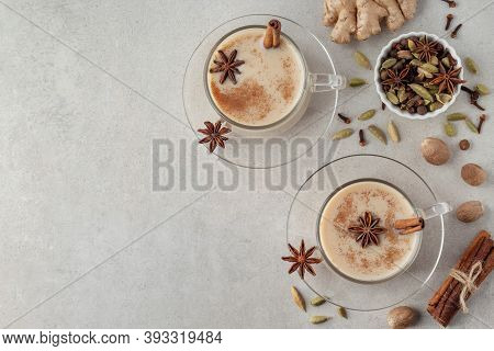Flat Lay Composition With Indian Masala Chai Tea And Different Spices On Grey Table, Copy Space. Hea