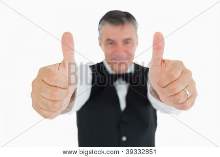 Cheerful man in suit with thumbs up