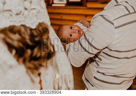 Baby Hand In Arms Of Godfather Rite Of Sacrament Of Epiphany