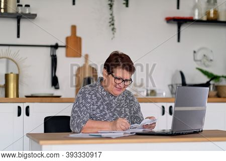 Old People, Tax Return And Home Banking. Worried Senior Lady Paying Federal Taxes, Doing Family Budg