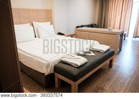Minimal Design In A Hotel Room. Brown Colors In Bedroom Interior. Comfortable Luxury Accommodation A