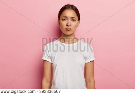 Gloomy Sad Asian Woman Has Unhappy Look, Expresses Regret And Sadness, Frowns Face, Being Frustrated