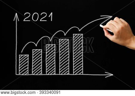 Hand Drawing Optimistic Increasing Growth Graph For Year 2021 With White Chalk On Blackboard. Recove