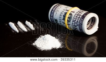 Roll of dollars and white drugs