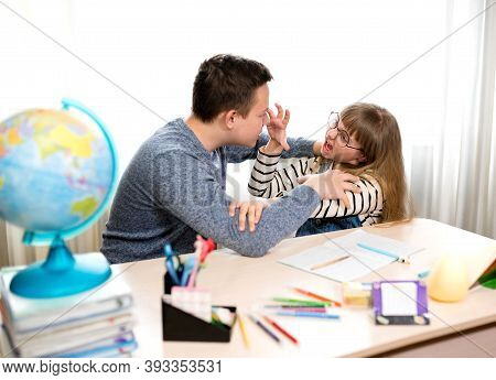 Stress Of The Child During Home Lessons. Nerves, Emotions, Children Screaming At Each Other. Home Le
