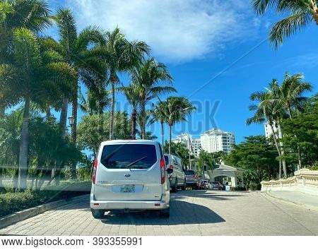 Naples, Fl/usa - 10/29/20:  A Line Of Cars Waiting To Check Into The Security Guard At A Luxury Cond