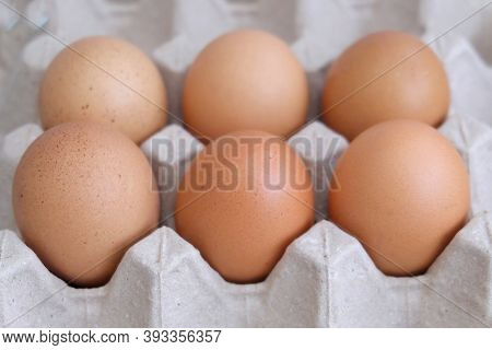 In Selective Focus A Group Of Fresh Eggs In A Paper Box And Selling At The Food Market