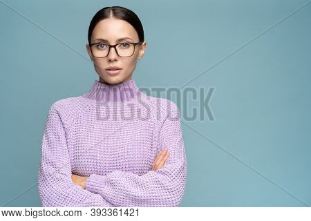 Self-assured Serious Business Woman In Sweater Wear Glasses Crossed Arms Over Body, Looking At Camer