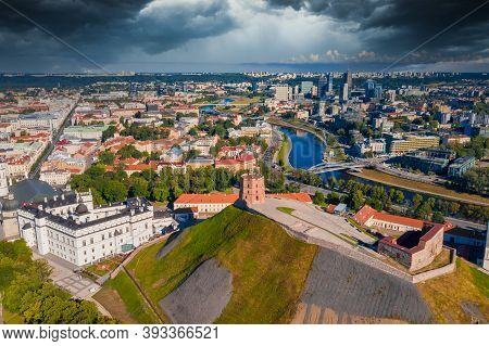 Aerial View Of Gediminas Castle In Capital Vilnius Of Lithuania With Lithuanian Flag On The Tower An