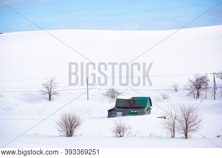 Wintery countryside and barnhouse in Biei, Japan.