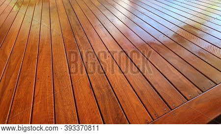 Freshly oiled Australian spotted Gum timber outdoor covered deck with Merbau stain at Residential Home, still wet and yet to dry