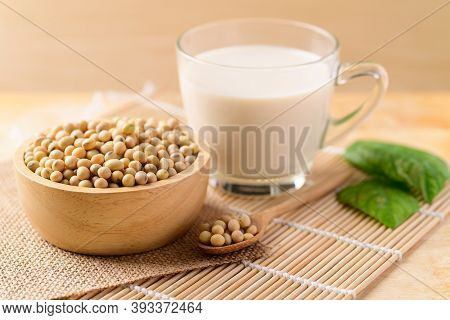 Soy Beans In A Bowl And Soy Milk In Glass On Wooden Background