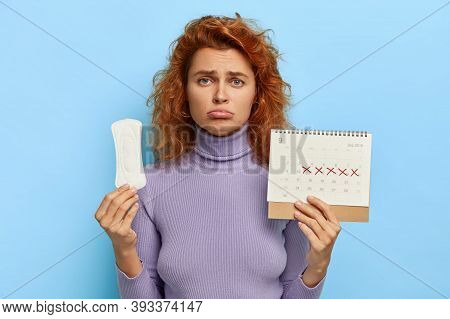 Unhappy Depressed Redhead Woman Being In Bad Mood, Suffers From Premenstrual Syndrom, Awaits For Cri