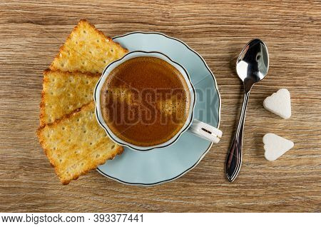 Crunchy Cookies With Sesame, Coffee Espresso In Light-blue Cup On Saucer, Spoon, Pieces Of Sugar On