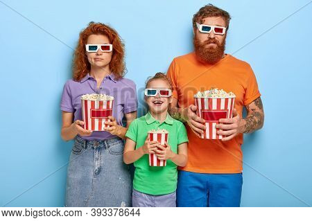 Bored Ginger Father And Mother Come On Cinema Together With Small Daughter For Watching New Cartoon