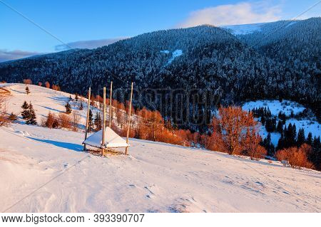 Winter Rural Landscape At Sunrise. Trees And Fields On Snow Covered Hills. Mountain Ridge In The Dis