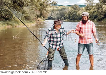 Fly Angler On The River. Angler. Family And Generation - Summer Holidays And People Concept. Fisherm