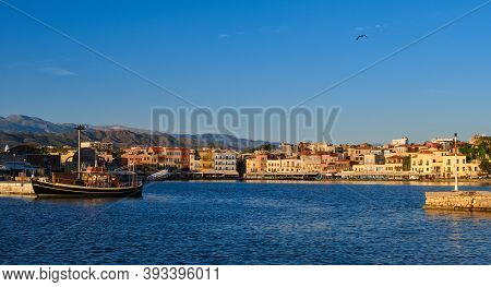 Beautiful View Of Old Venetian Harbour Of Chania, Crete, Greece, Quayside, Tourist Boats By Piers In