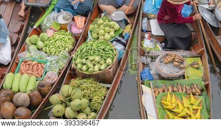 Damnoen Saduak Floating Market Or Amphawa. Local People Sell Fruits, Traditional Food On Boats In Ca