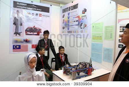 SUBANG JAYA - NOV 10: Unidentified Malaysian students shows their robot nurse who can communicate and check patient's vital signs at the World Robot Olympaid on Nov 10, 2012 in Subang Jaya, Malaysia.