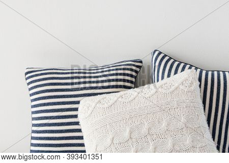 Striped and knitted home cushions