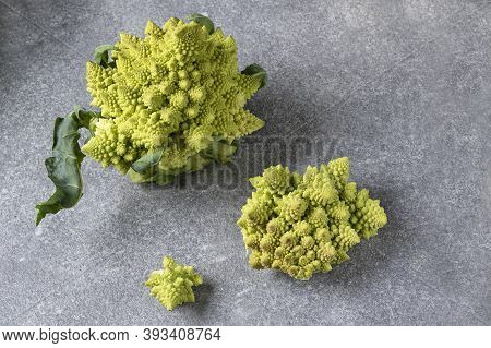 Roach Of Romanescu Verdone Cabbage And Inflorescences On A Gray Background, Top View. Detox Menu. Ve