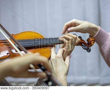 Helping The Teacher To Keep His Hand On The Violin Correctly, Placing Children's Hands When Playing
