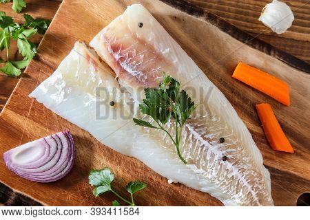 Alaskan cod fillet on cutting board