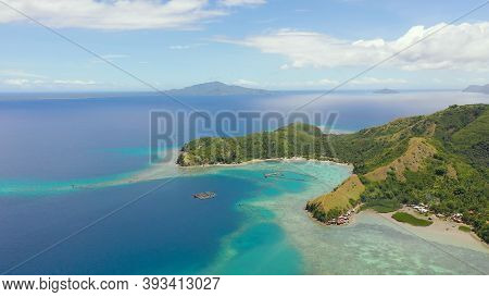 Seascape With Tropical Islands And Turquoise Water. Sleeping Dinosaur Island Located On The Island O