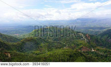 Lush Green Rainforest In The Mountains. Aerial Drone View Of The Jungle Located On The Island Of Min