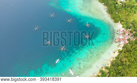 Aerial Drone Of Village Of Fishermen With Houses And Fishing Boats. Samal Island, Philippines, Minda
