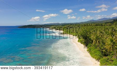 Tropical Landscape With A Beautiful Beach In The Blue Water. Philippines, Mindanao. Summer And Trave