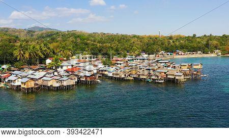 Village Of Fishermen With Houses On The Water, With Fishing Boats. Fishing Village With Wooden House