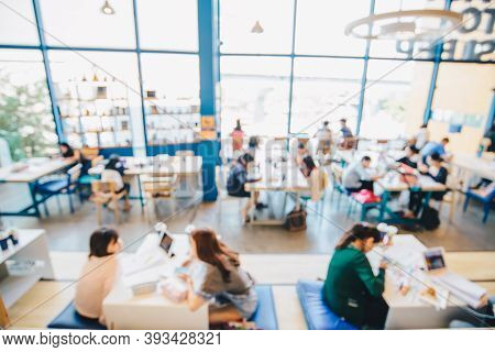 Blurred People Co-working Space In Coffee Shop