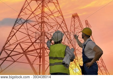 Professional Engineers Working On Installation Of Electrical Substation Outdoors