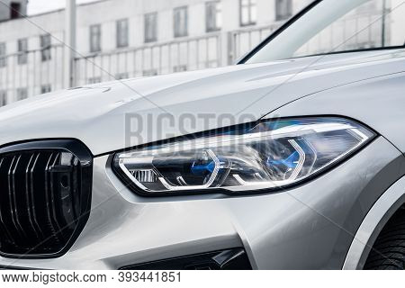 Car Xenon Lamp Headlight. Exterior Of A Expnesive Car. View Of The Front  Of The Car.new Car Headlig