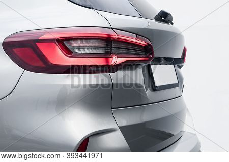 The Back Of A Silver Expensive Crossover Car:  Bumper, Trunk Lid, Taillight On The Back White Backgr