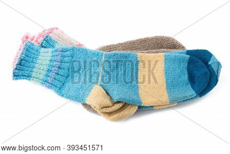 Pair Of Striped Handmade Knitted Warm Socks Made Of Sheep's Wool Yarn, Clothing Is Isolated On A Whi