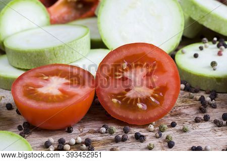 Cut Into Pieces Sweet Red Tomato, Cutting Board On Which The Ingredients For The Salad Are Prepared,
