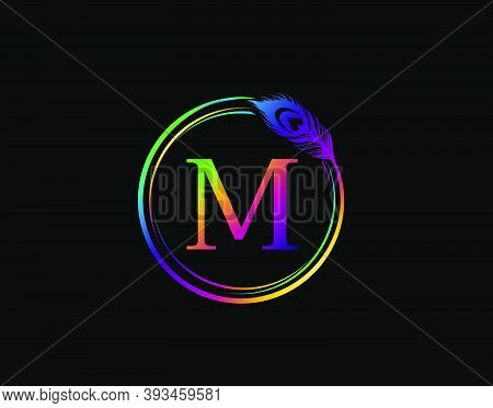 M Letter Decorated With Hologram Color Peacock Feather. Circle Badge With Peacock Feather.