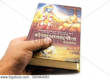 Bhagavad Gita Book Isolated On White Background With Selective Focus