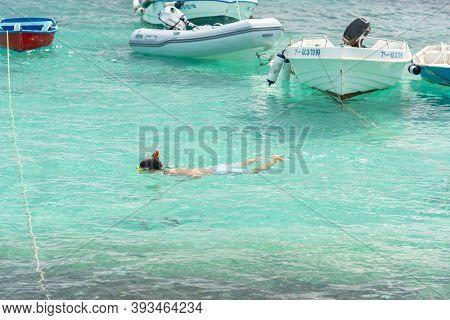 Isla Lobos, Fuerteventura, Spain: 2020 October 3: Boy Swming The Isla Lobos Pier In Fuerteventura In