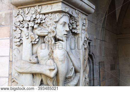 Duisburg City Hall In Germany. Architecture Detail Depicting Eve In The Garden Of Eden Being Tempted