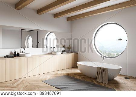 Corner Of Modern Loft Bathroom With White Walls, Wooden Floor, Comfortable Bathtub And Double Sink W