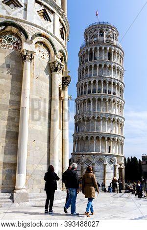 Pisa, Italy - March 17, 2012: People Walking Near The Tower Of Pisa Or Torre Di Pisa