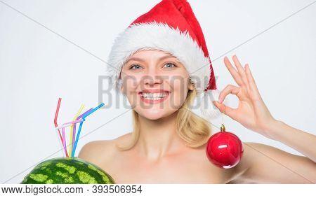 Detox After Christmas. Watermelon Dietary. Girl Santa Hat Hold Ornament Ball Drink Watermelon Cockta